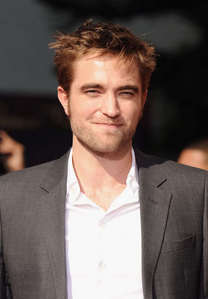 my gorgeous Robert wearing a suit with a pocket<3
