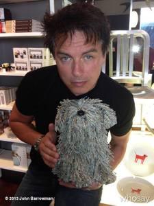 "John Barrowman holding onto a ""puppy""."