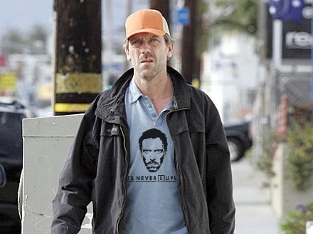 """Hugh Laurie wearing a """"its never lupus"""" T-shirt"""