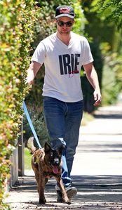 my baby with his dog Bear's leash in his right hand<3