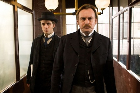 my gorgeous Robert with one of his co-stars in a scene from Bel Ami<3