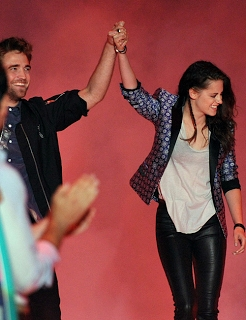 my sexy British babe grabbing Kristen's hand from the 2012 Teen Choice Awards<3