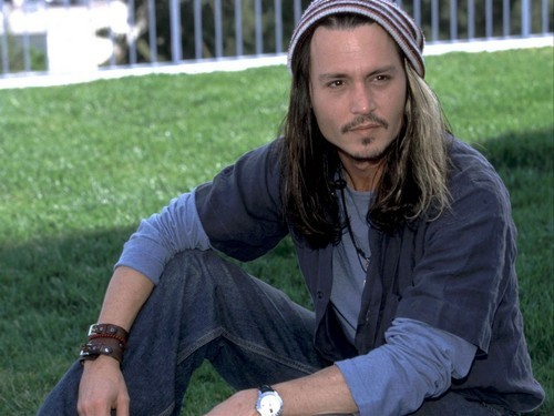 Johnny Depp wearing blue .
