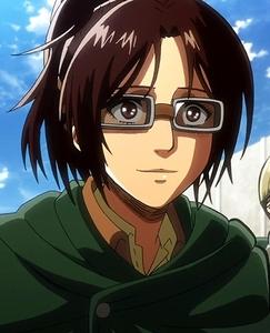 Hanji Zoe from Shingeki no kyojin (Attack on titan). When she is fighting, she wears goggles but when she is normally walking around, she wears glasses.
