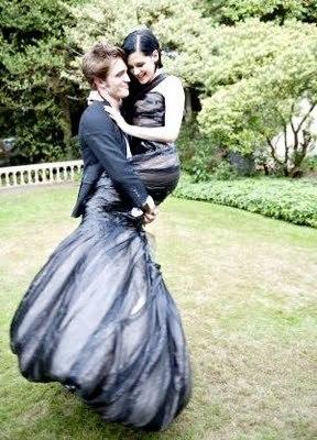 my handsome baby holding Kristen Stewart in his arms from their 2009 Harper Bazaar photoshoot<3