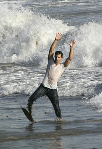Twilight hottie Taylor Lautner with his arms up from his Rolling Stones photoshoot<3
