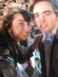 here's a slightly blurry pic of my baby with a fan,but toi can totally tell it's him<3