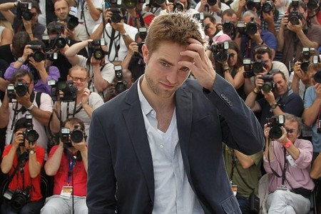 my handsome baby at Cannes with lots of cameras behind him<3