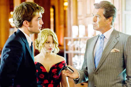 Robert with his Remember Me dad,Pierce Brosnan<3