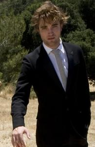 he looks sinfully sexy in any suit he wears<3
