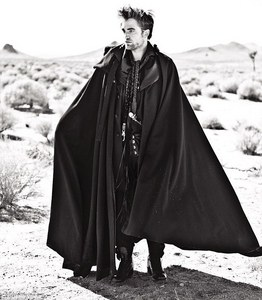 my sexy Robert wearing a cool cape from hie Italian Vogue photoshoot<3