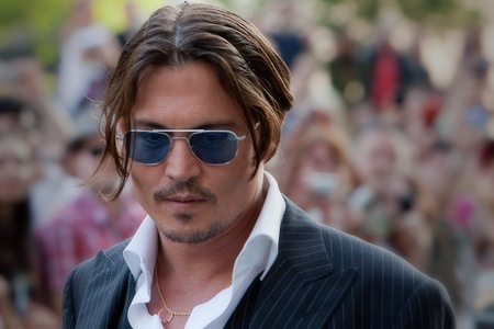 Johnny depp With a gold ring on a gold chain