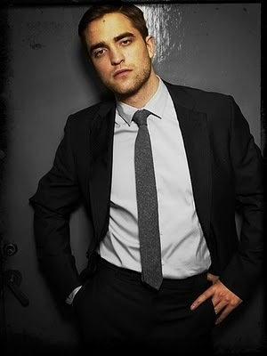 he looks sexy in any suit he wears<3