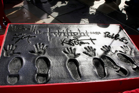 it may not be a তারকা on the Hollywood Walk of Fame,but my handsome Robert and his 2 co-stars cemented their hands and feet in cement<3