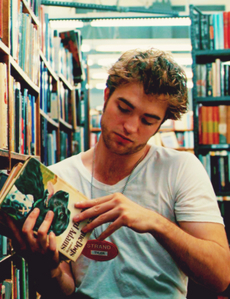 my handsome baby looking at some Книги in his hands<3