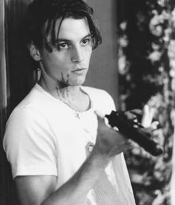 Skeet Ulrich with a gun in Scream :)