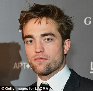 Robert with hair hanging down on his forehead<3