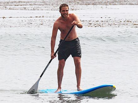 my ビーチ babe standing on his paddleboard<3
