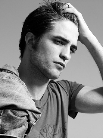 my beautiful Robert has his hand in his hair in almost every single picture of him<3