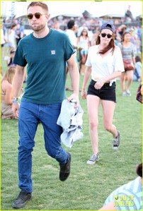 Robert in front of Kristen as they leave Coachella<3