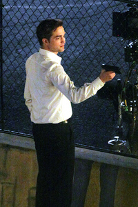 my handsome baby with a gun on the set of Cosmopolis<3