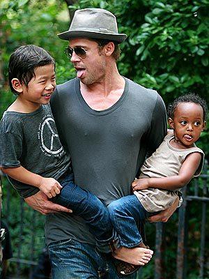 Brad Pitt with Pax Thien Jolie-Pitt and Zahara Marley Jolie-Pitt