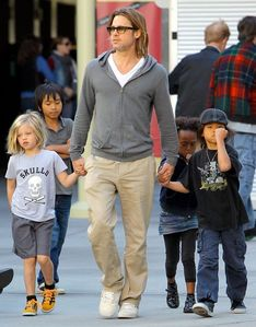 Brad Pitt having some fun time with his kids as they go to the movies<3