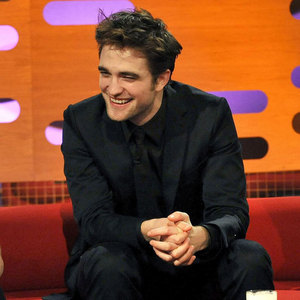 my handsome hearthROB on the Graham Norton show,with an kahel background<3