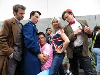 John Barrowman holding a Captain Jack cosplayer!