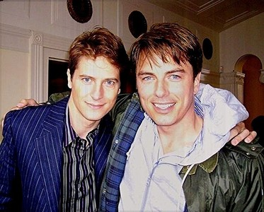 "John Barrowman with his husband, Scott Gill<3 He is my favourite entertainer in the whole world. Hes just so genuine and he really does care about his fans.. Why is John my idol? John is my idol because of his attitude in life. He receives hate about his sexuality, his accent, the way he acts, the way he sings, his opinions, etc etc BUT he just sticks the finger up to all haters and keeps on doing what he does. He cares about his fans and its probably like a segundo family to him. We give him puwang when he needs it and he repays us sa pamamagitan ng stopping and giving us time when he doesnt need to. Not alot of celebrities would do that. He interacts with us on twitter and social media and shares his life with us and doesn't hide away. He inspires so many people because of his ""I AM WHAT I AM"" attitude in life and I thank him for that. He says what he thinks and thats what i pag-ibig about him . He hasn't changed just because hes famous. He has stayed the same and hes one of the most, if not the most, genuine celebrity out there."