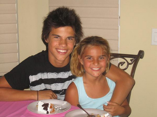 a younger Taylor Lautner with his little sister<3