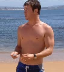 the sexy Chris Hemsworth on a beach<3