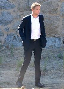he is just sooooooo yummy in that suit<3