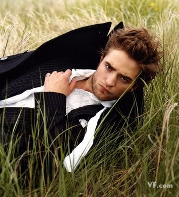 my handsome Robert lying in the grass<3