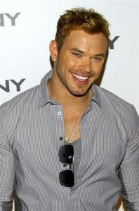 Kellan with sunglasses on his shirt<3