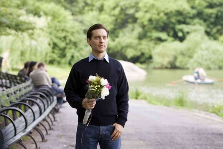 Itsy Sexy spin ' Tobey ' holding flowers