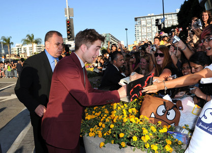 my sweetie signing autographs at the Eclipse premiere<3