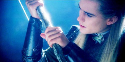 my fave elf,Legolas,played سے طرف کی Orlando Bloom holding a bow<3