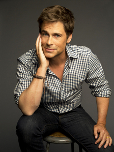 Rob Lowe holding his head