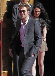 my handsome British hottie with the lovely,beautiful Kristen Stewart behind him<3