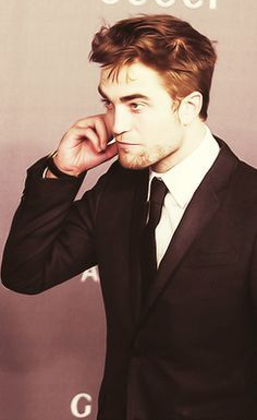 my gorgeous Robert wearing a black suit jacket<3