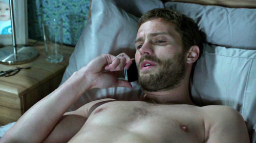 Jamie lying down on a bed<3