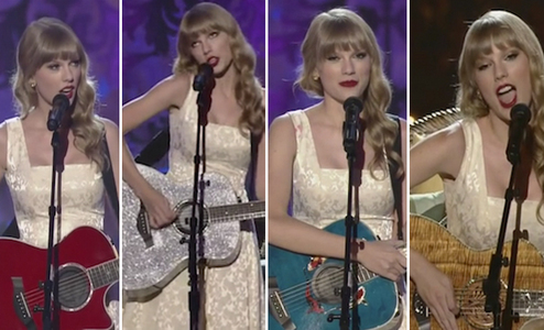 Taylor holding a guitarra