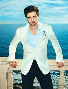 my handsome Robert in a white suit jacket<3