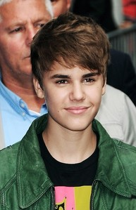 Justin with his hair going to the side<3