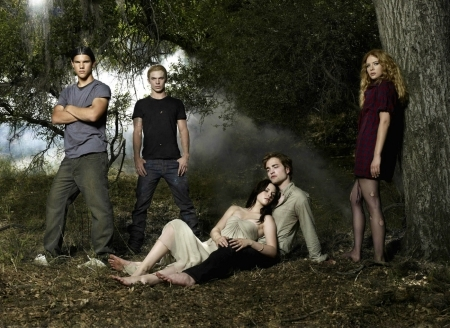 a Twilight photoshoot with Robert,Kristen,Taylor,Cam and Rachelle in front of trees<3