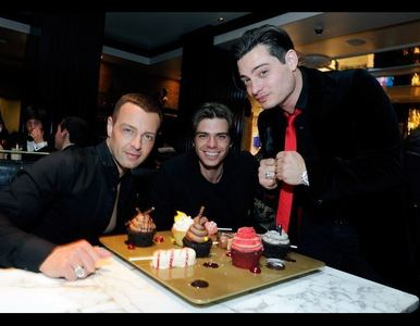 Matthew & his brothers with sweets in front of them :)