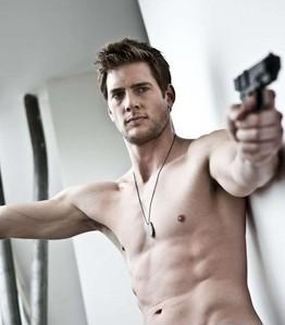 Ryan McPartlin holding a gun