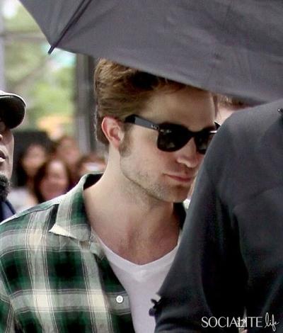 Robert with an umbrella<3