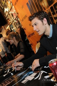 Alex signing autographs to promote his movie I Am Number Four